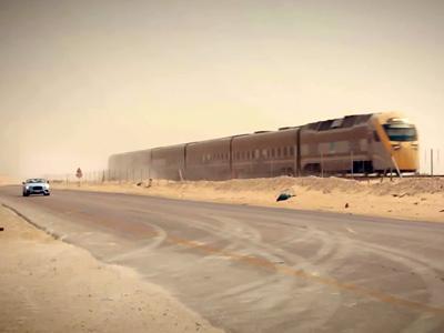 Une Bentley défie un train à grande vitesse